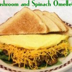 our fluffy three egg omelette with grilled mushrooms, fresh baby spinach and shredded cheddar ch