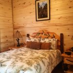 Queen bed suite in Trails End cabin