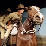 Wounded soldier saved by comrade during Boer War.