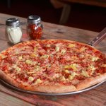 The Panamaniac Pizza: Ham, bacon, fresh cut pineapple, mozzarella.