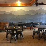 Our new, painted by hand mountain mural! Thanks to our wonderful baristas!