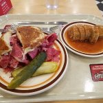 Corned Beef Reuben - Stuffed with corned beef, grilled with swiss and sauerkraut with 1000 dress