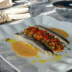 steamed European seabass on a bed with lentil, mushroom-vegetable ragout and tarragon sauce