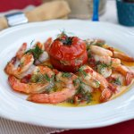 Tiger prawns served with artichoke filled tomato, topped with garlic sauce