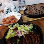Beef bulgogi and kimchi salad at the back