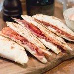 Piadina with Parma ham seasoned 16 months, tomato slice & mozzarella cheese