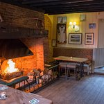 R&C back bar with roaring fire