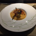 Roasted Scottish lobster and young vegetables in a saffron bisque