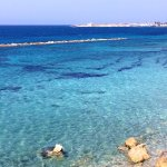 Walk into Paphos with clear blue sea