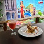 Parmesan encrusted Snapper with a Lobster Cream Sauce, enjoy it with a strawberry margarita!!