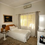 SINGLE ROOM with full en-suite facilities, air-conditioning, TV and mini fridge.