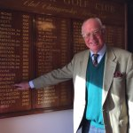 Past R&A Captain Colin Brown points to his fathers name on the Championship board