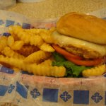 Grilled Chicken Sandwich with Swiss Cheese and Fries