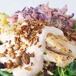 Roast cauliflower with grain salad, dressed greens and harissa yoghurt dressing.