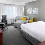 Our spacious king guest rooms feature comfortable bedding, a well-lit work desk, and modern déco