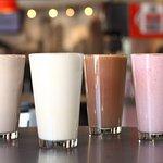 Peanut butter, vanilla, chocolate, and strawberry milkshakes