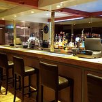 Main Bar with four TVs showing BT Sport, with pool and your choice of music