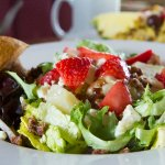 Garry's Salad with maple chanpagne dressing, strawberries, candied pecans, gorgonzola and pears.