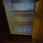 Empty fridge in room