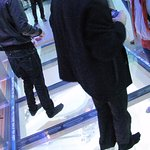 Brave trying to stand on the glass floor