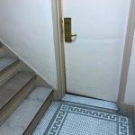 Door to room in stairwell - not in area with rest of rooms