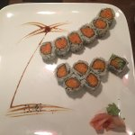 I had to post this with such a nice portrait on the plate. Spicy salmon and spicy tuna rolls....