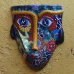 Ceramic mask decoration.