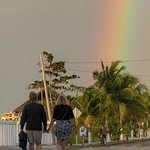 lovers and favorite guest Sandy and Ed walking to Blue Angel Resort with a rainbow showing the w
