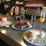 Biscuits & Gravy w/egg, Nutella Swirl Griddle Cakes, Breakfast Burrito, and Mimosas
