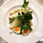 Spring asparagus, green peas with quail egg and puffed barley