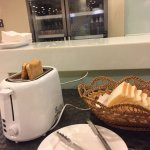 Only one toaster w 2 holes for 30+ over customers in a hotel. Also, dirty plate!