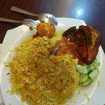 Briyani rice with hard boiled egg and fried chicken