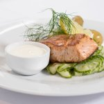 Classic Norwegian salmon served with cucumber salad, boiled potatoes and sour cream.