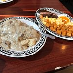 The biscuits and gravy breakfast with scrambled eggs, sausage, and their amazing home fries.