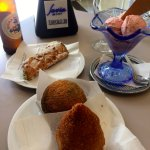 Arancini, cannolo, gelato and beer
