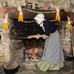 Mrs. Morehouse baking bread at Kings Landing, Fall 2016