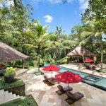 The main area of Villa The Sanctuary Bali with lap pool, kids pool and jacuzzi.