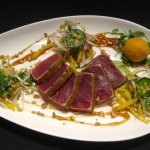 avocado leaf-seared yellowfin tuna with homestead green mango salad, aji amarillo sorbet, fish s