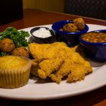 Fried catfish with hushpuppies and beans