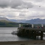 The pier at Beaumaris with views over to Snowdonia