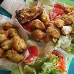 Grilled chicken with sauce chien, Codfish fritters