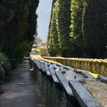 Famous Villa d'Este waterfall in garden looking down to Lake Como