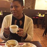 Alysia enjoying her cup of Indian Tea with Dal soup and spring rolls