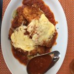 Chicken Parmigiana with extra sauce (before peppering and more Parmesan)