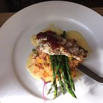 monk fish atop wild rice with baby asparagus