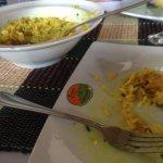 Frango caipira, arroz e pequi
