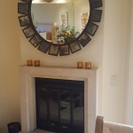 The fireplace and mirror