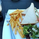 Smoked salmon cheese sandwich and chips with Guinness