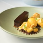 Dark chocolate terrine, passionfruit, mango sorbet and chocolate crumb
