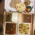 Nicely arranged in room Indian Thali
